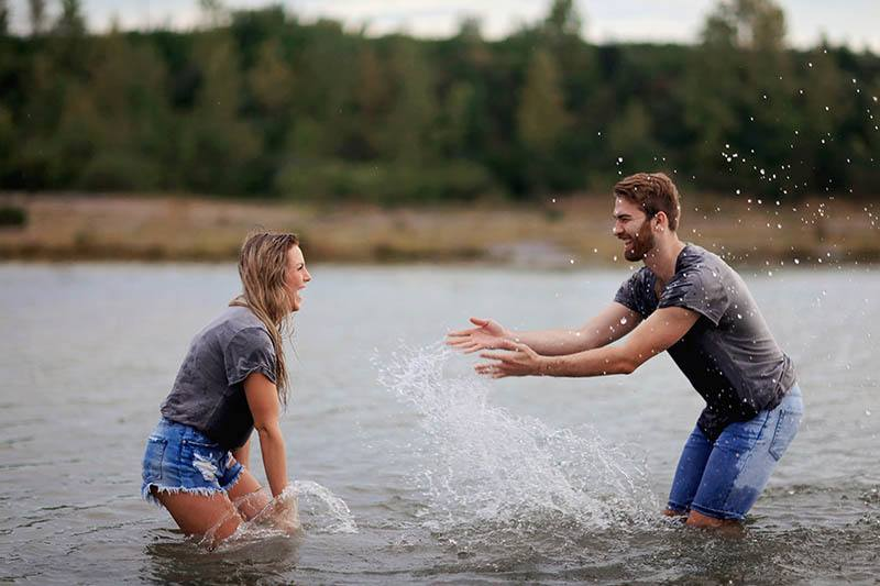 happy couple playing in the water
