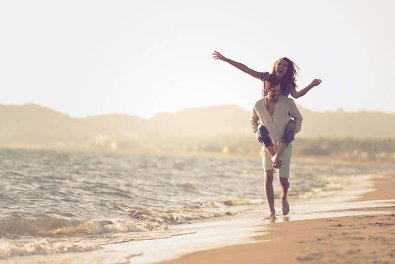happy couple walking in the seashore