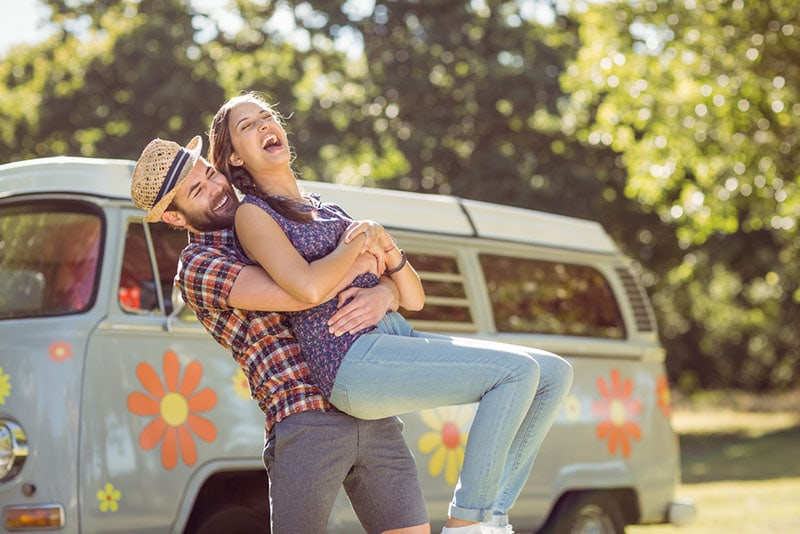 happy man holding woman in the air