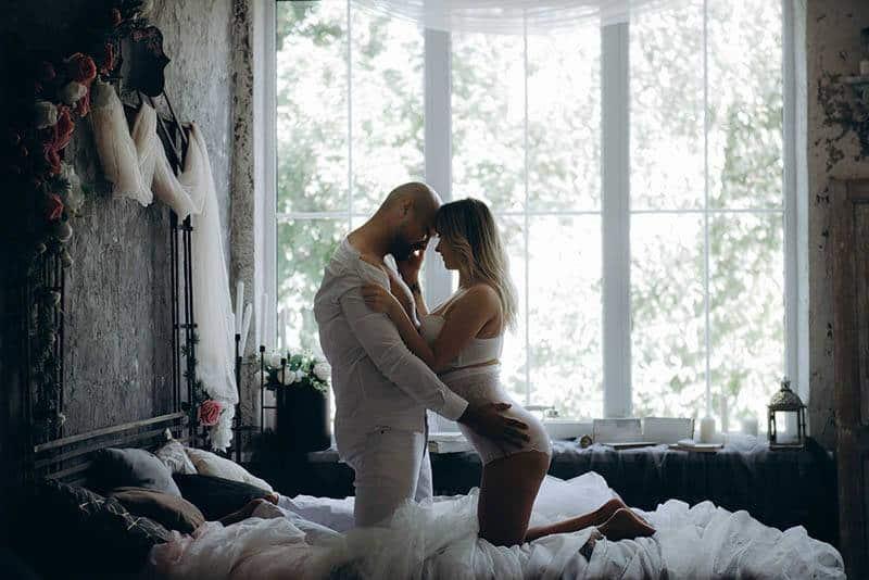 lovers hugging in bedroom