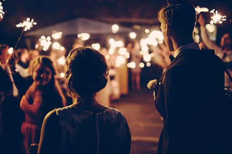 man and woman at weeding party