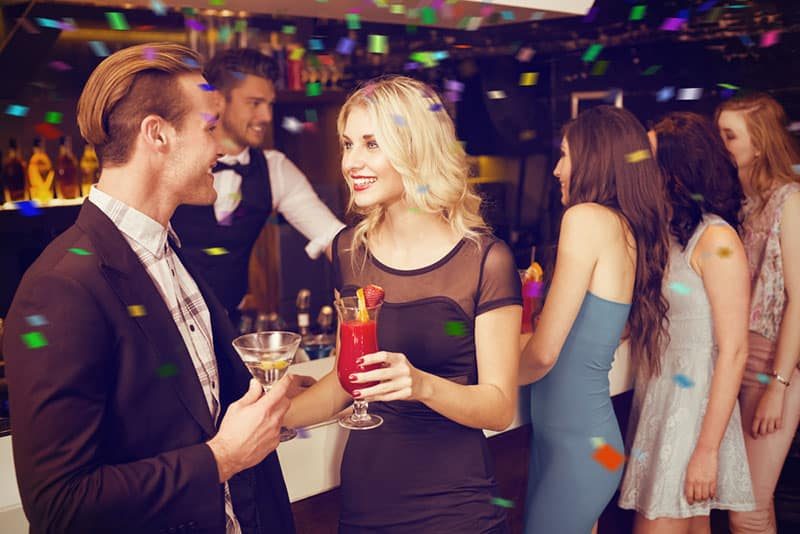 man flirting with woman in the bar