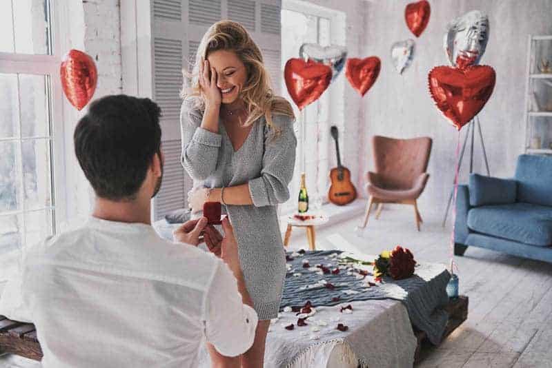 man proposing woman at home
