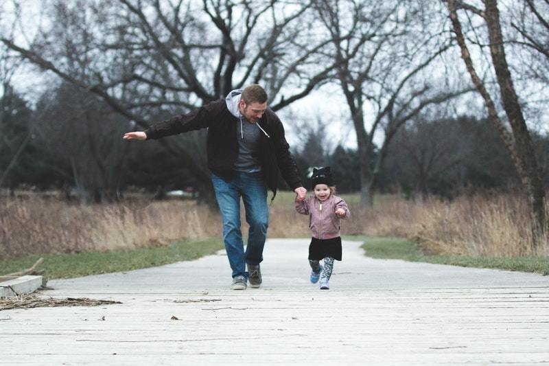 man running with little girl