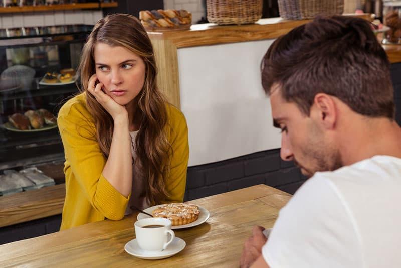 serious couple having breakfast