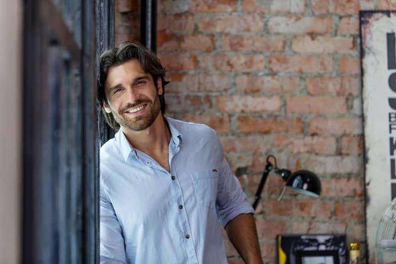 smiling man in shirt posing