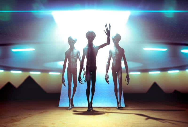 three aliens landing with ufo on earth