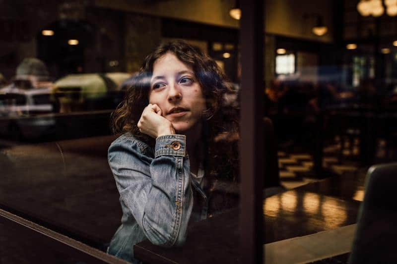 woman in cafe looking out