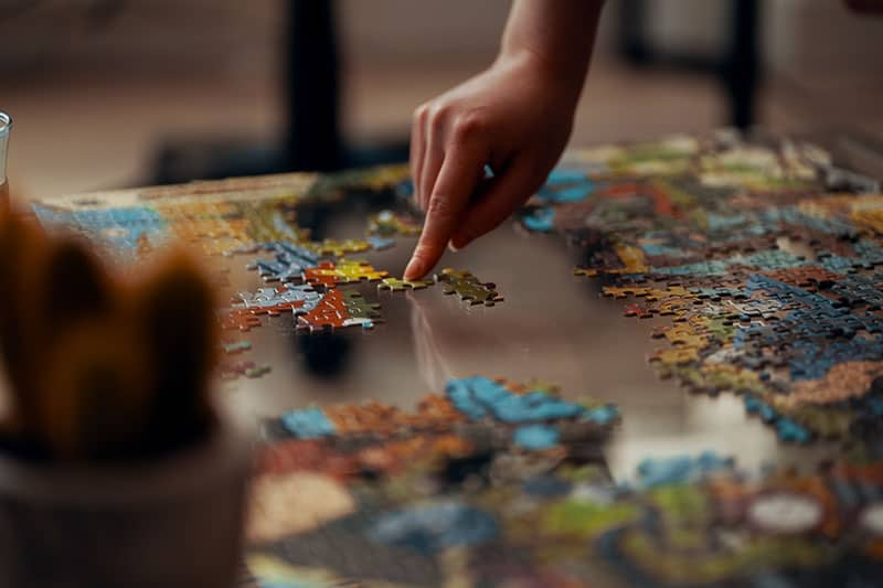 woman playing with puzzles