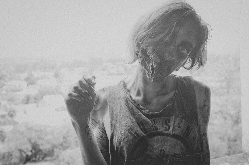 woman zombie posing at camera