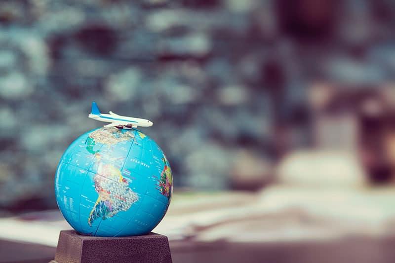 world globe and aeroplane on it