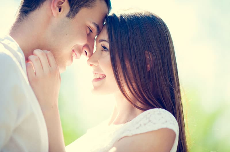 young couple hugging and looking at each other