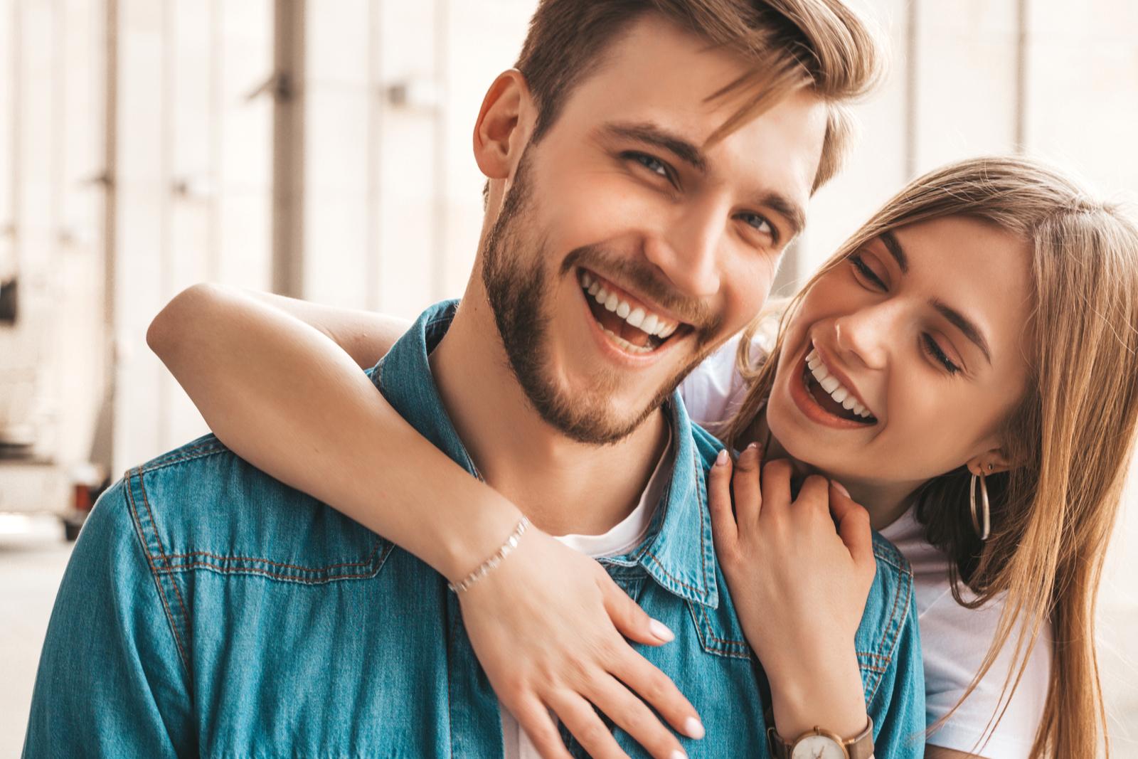 a smiling loving couple hugs