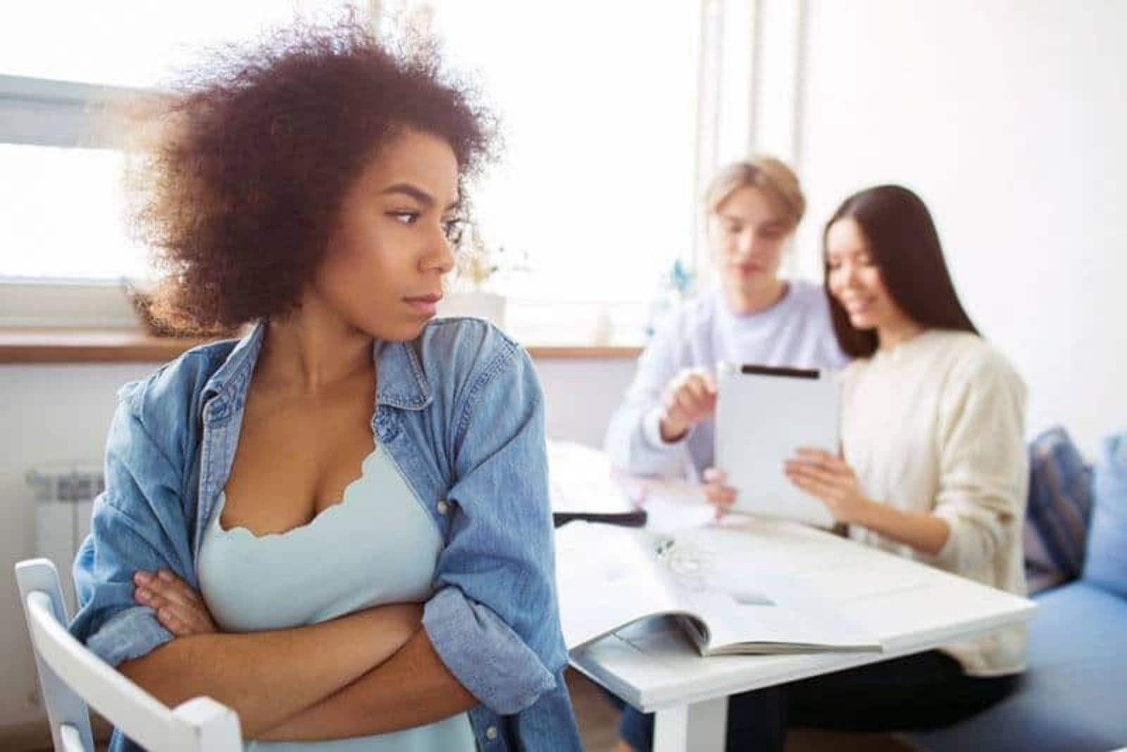 a woman angry at her friends turned her back on them