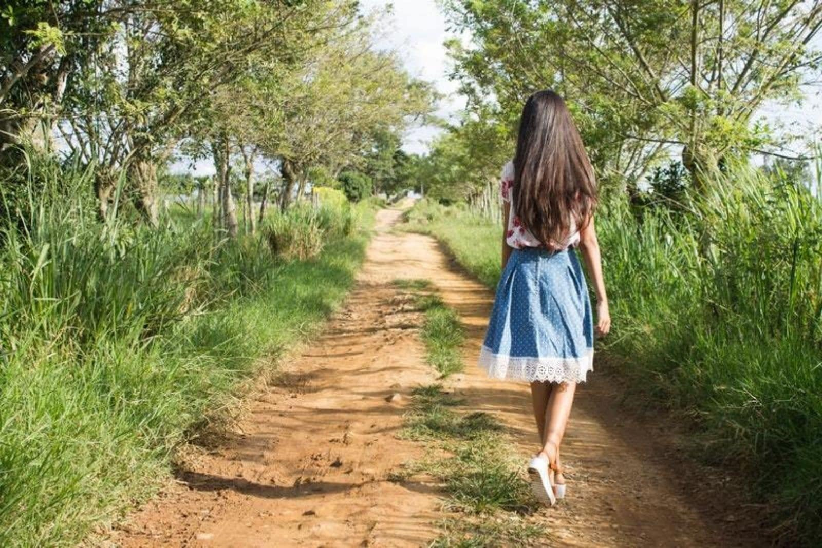 a woman with long black hair sets her back turned