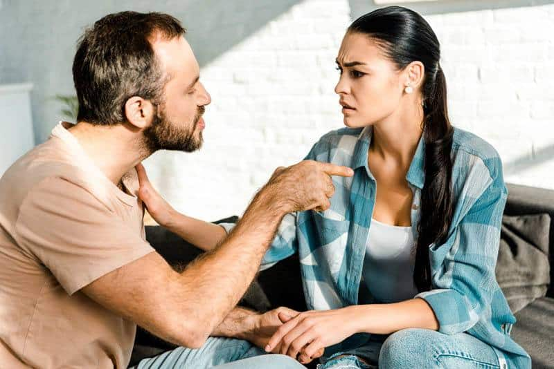 angry man pointing finger on woman