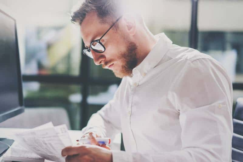 bearded businessman working at modern office