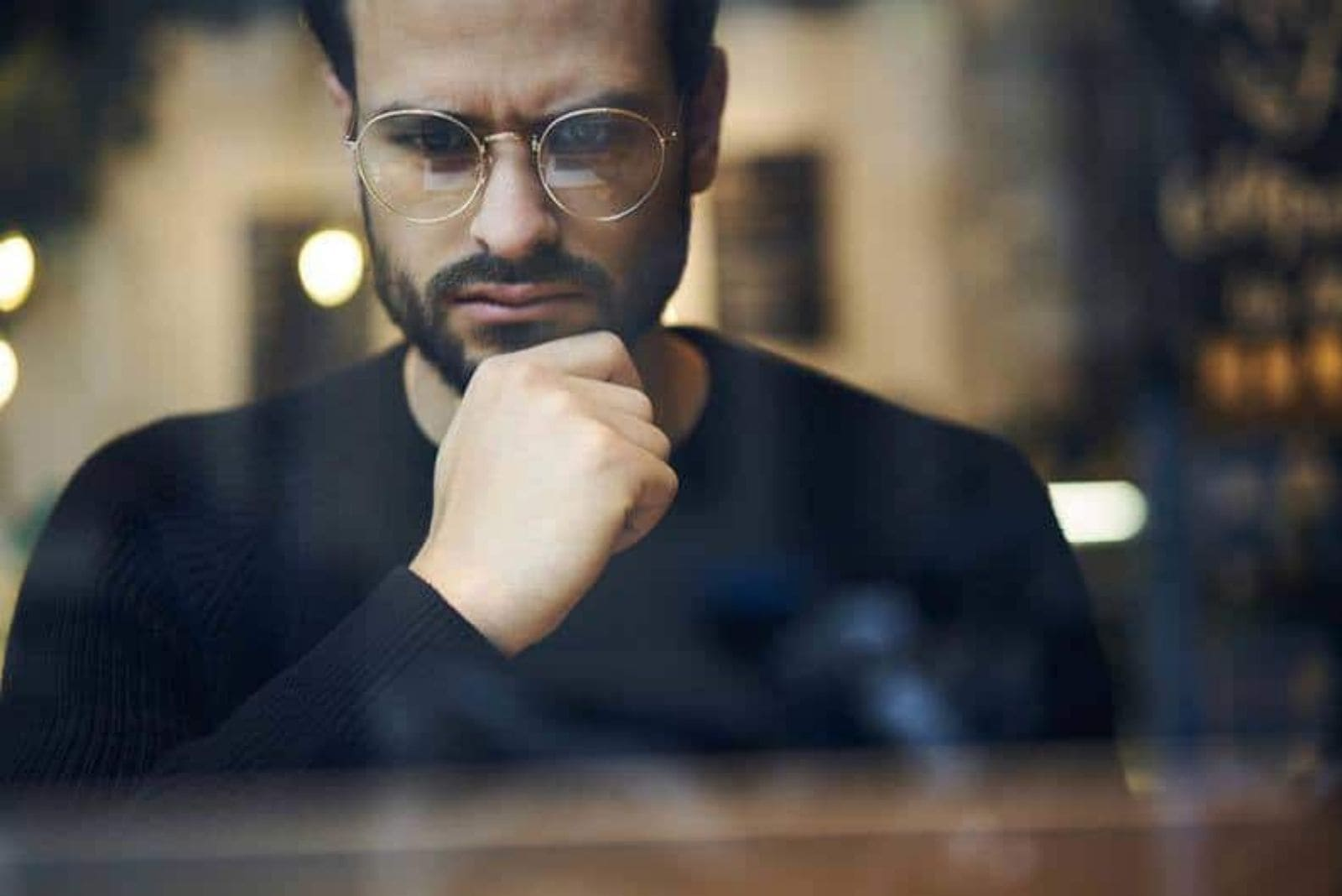 bearded man with glasses looking worried
