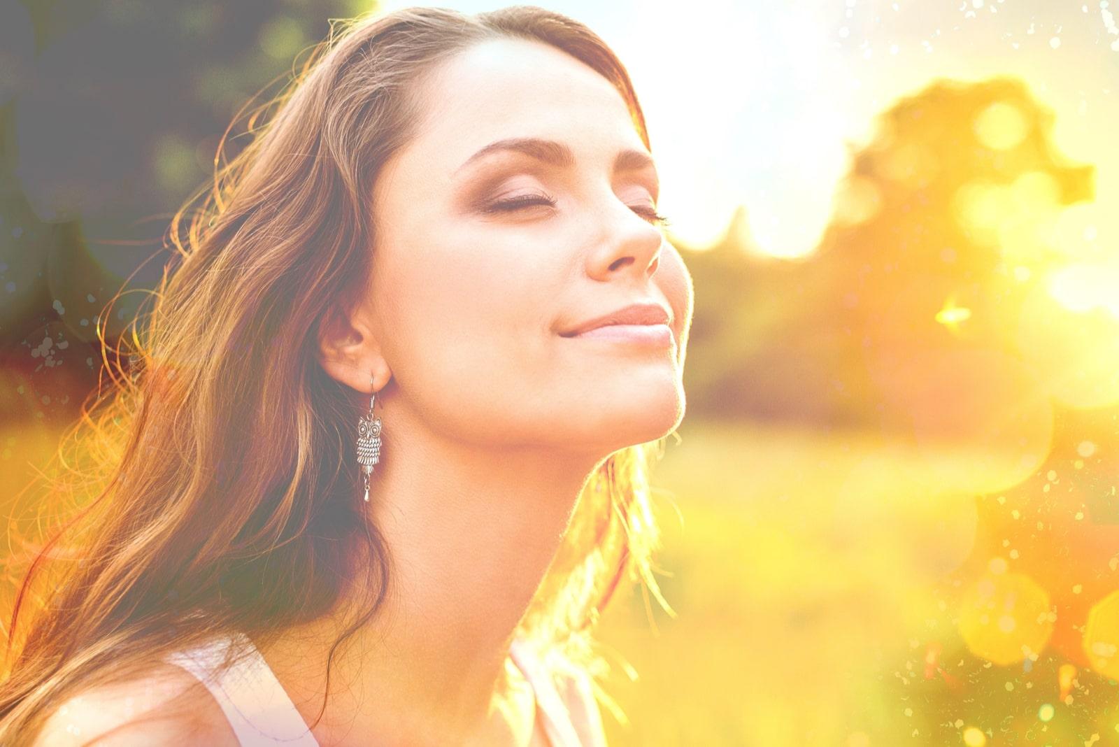 beautiful brunette woman in nature