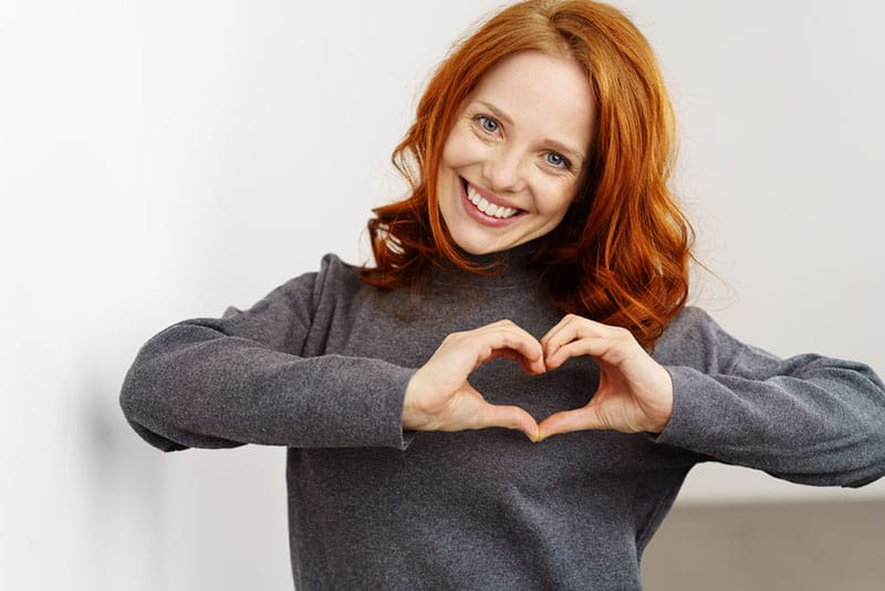 beautiful woman making heart with hands