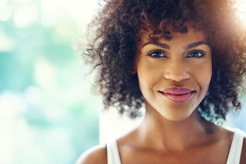 beautiful woman with curly hair smiling