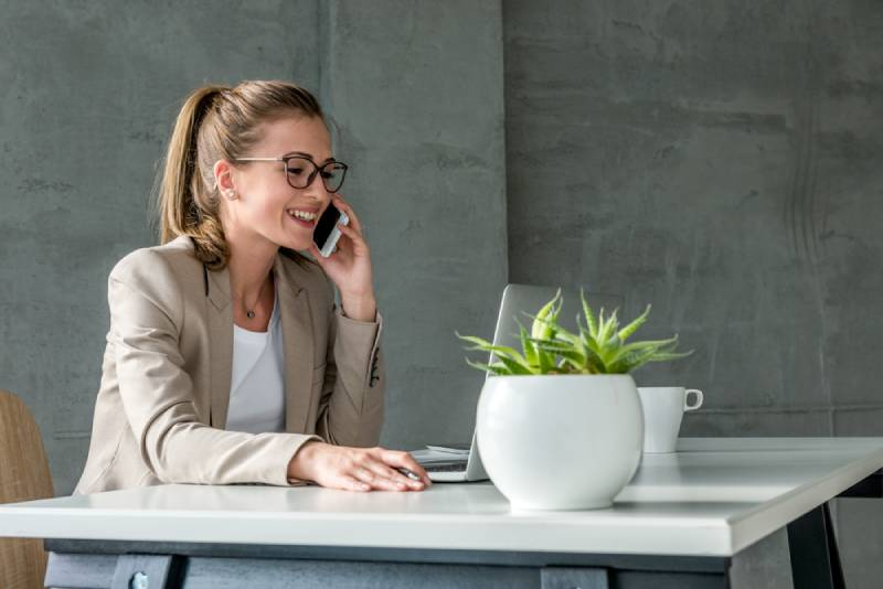 business woman having a call while sitting at desk