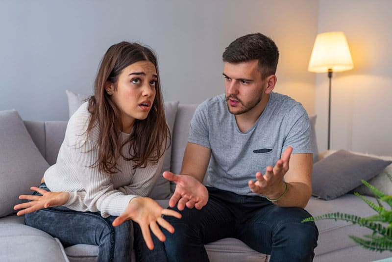 couple having serious conversation at home