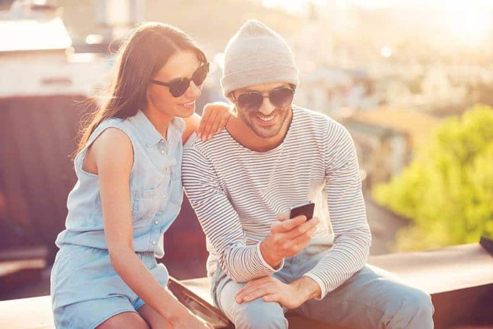 couple looking at smartphone and smiling