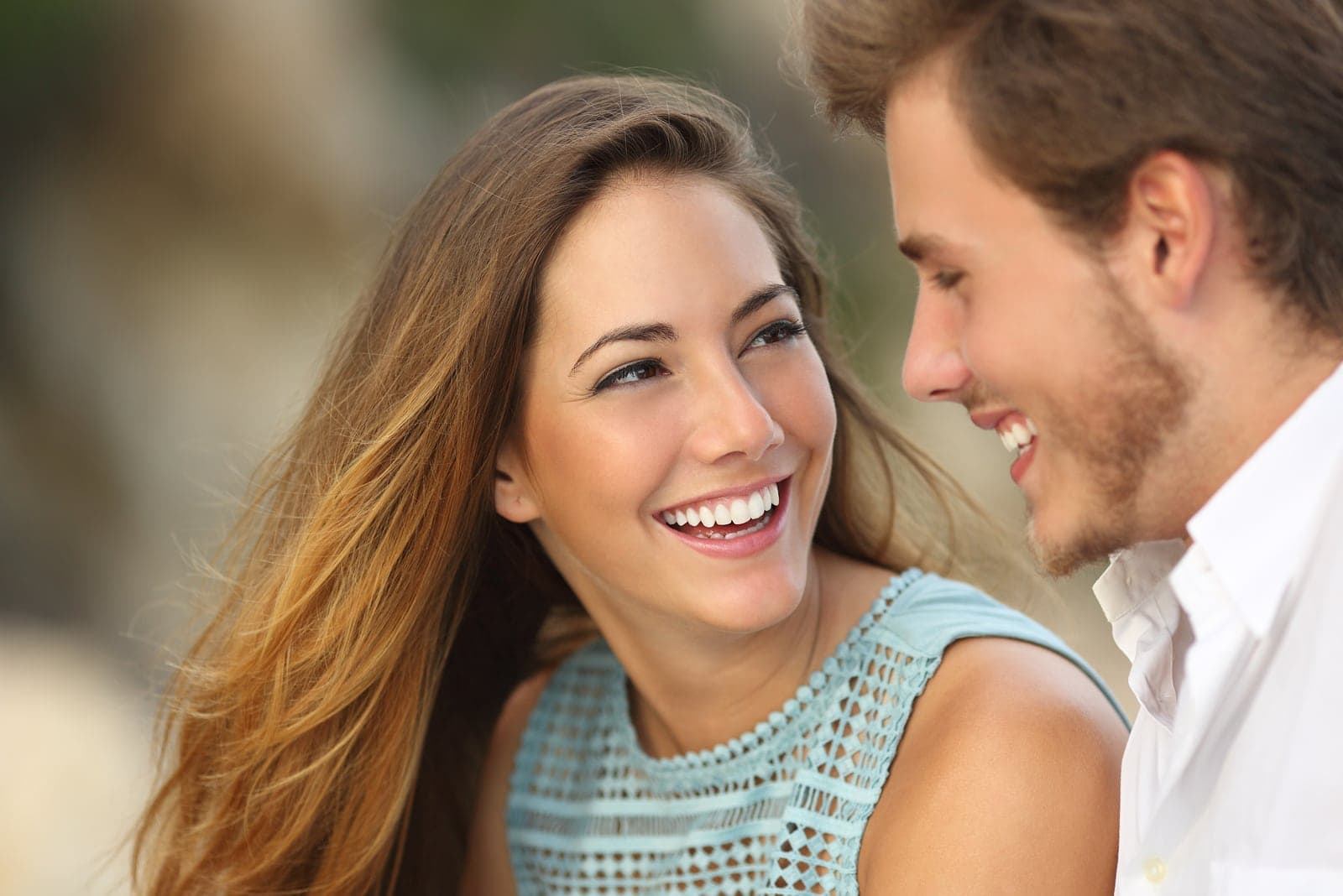 couple looking into eyes while laughing