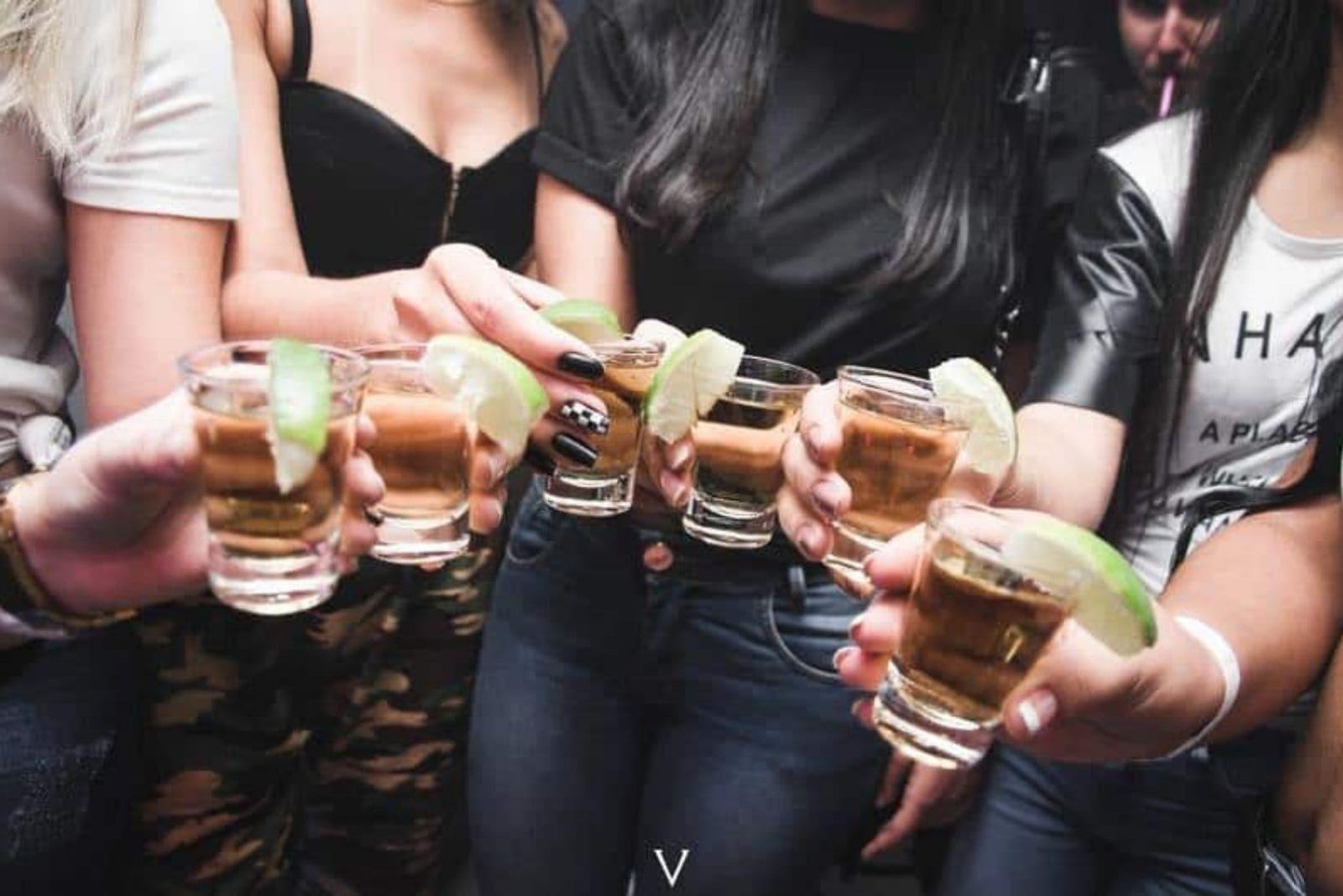 friends drink tequila