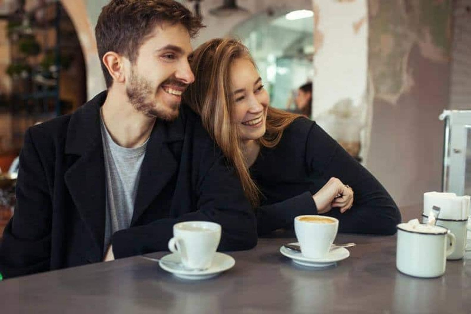 happy couple drinking coffee and laughing