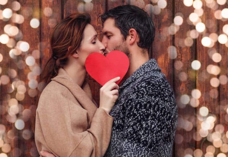 happy couple kissing outside