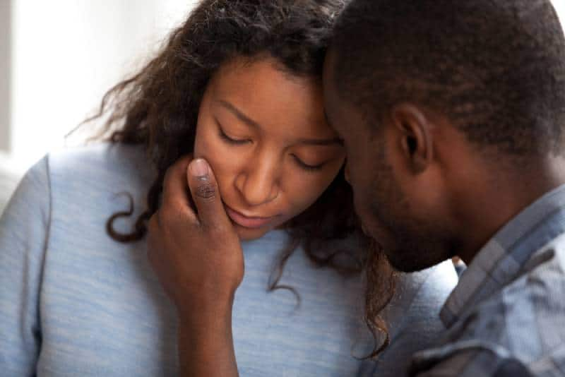 husband apologizing sad wife