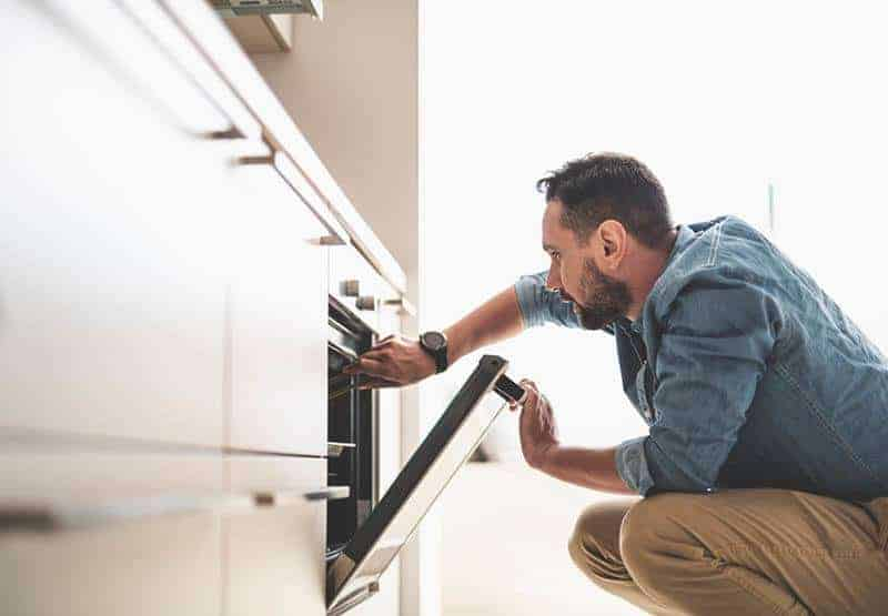 man opening oven