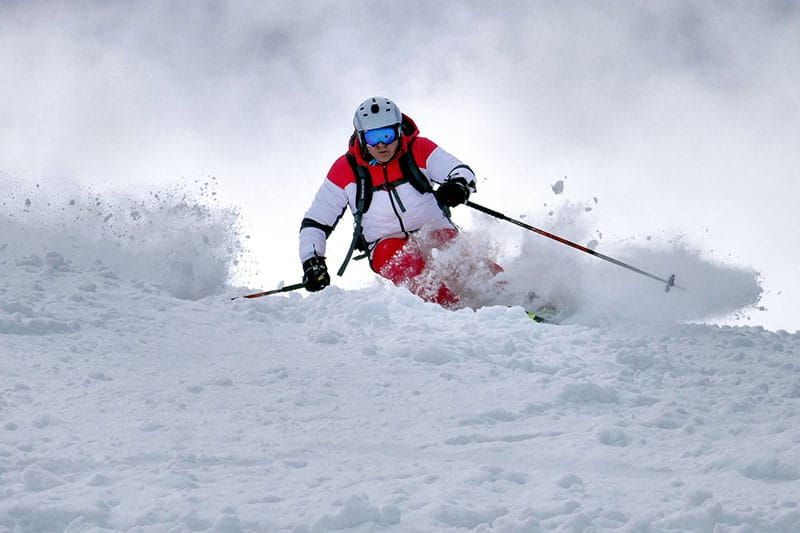 man skiing on the snow