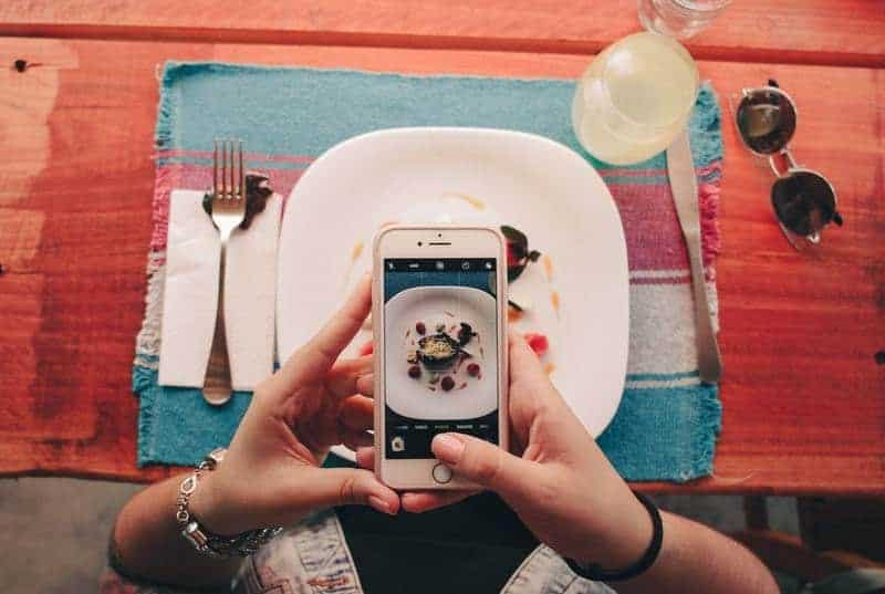 man taking picture of food