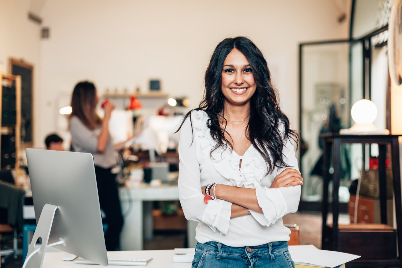 portrait of a beautiful smiling brunette in the office