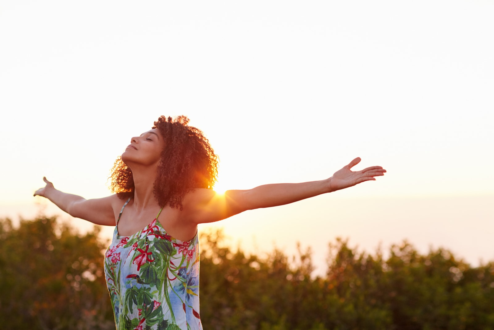 relaxed woman  with her arms outstretched