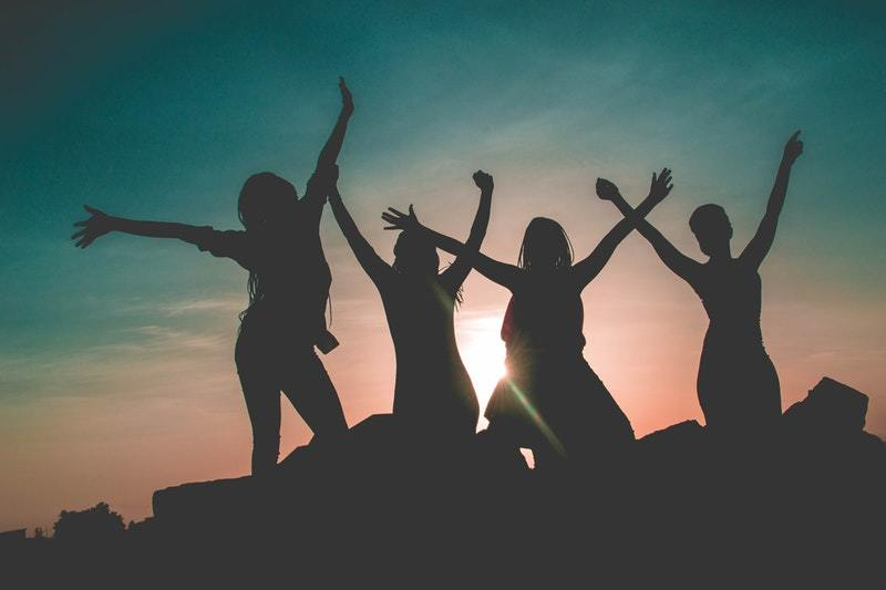 silhouette of happy female friends