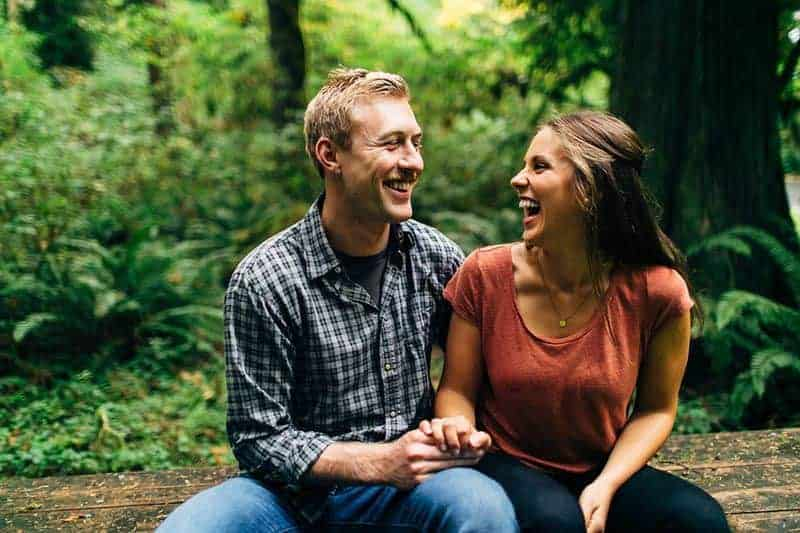 smiling couple talking in nature