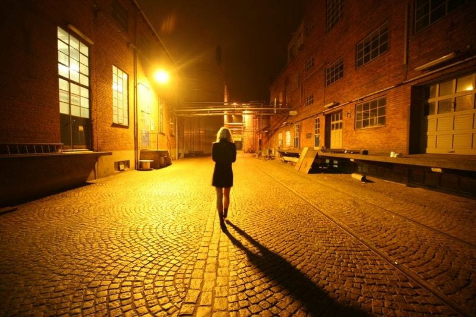 the woman walks down the street alone