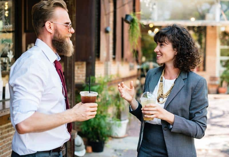woman and man talking outdoor