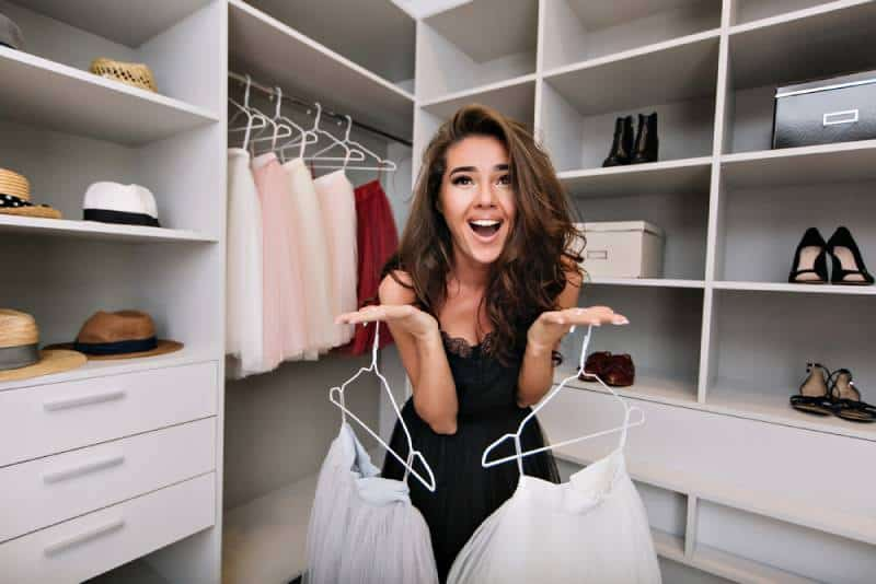 woman asks for help in choosing clothes in a dressing room
