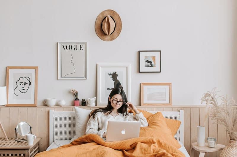 woman deleting photos on laptop