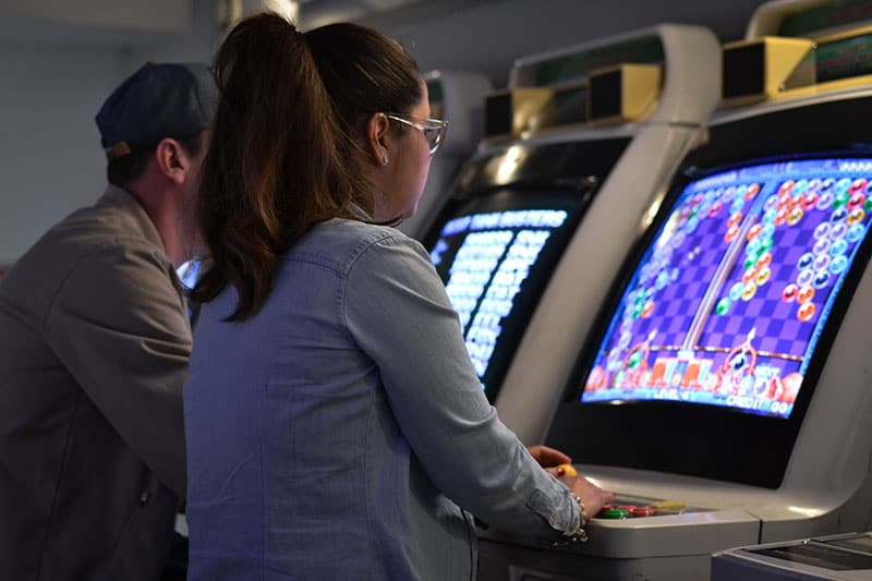 woman playing video game on the machine