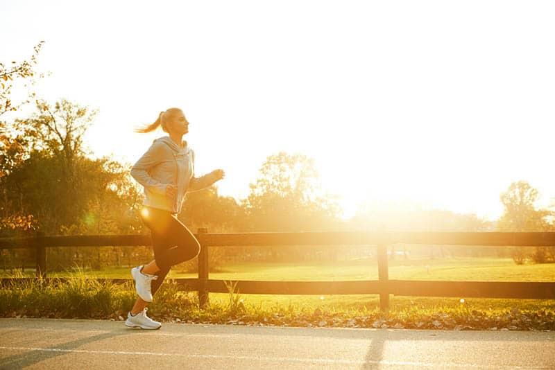 woman running on sunset