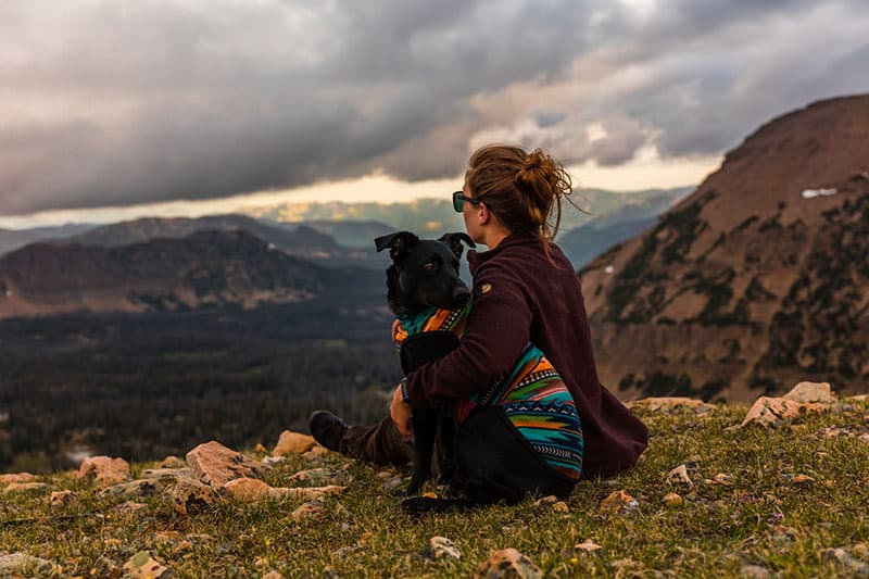 woman sitting with her dog