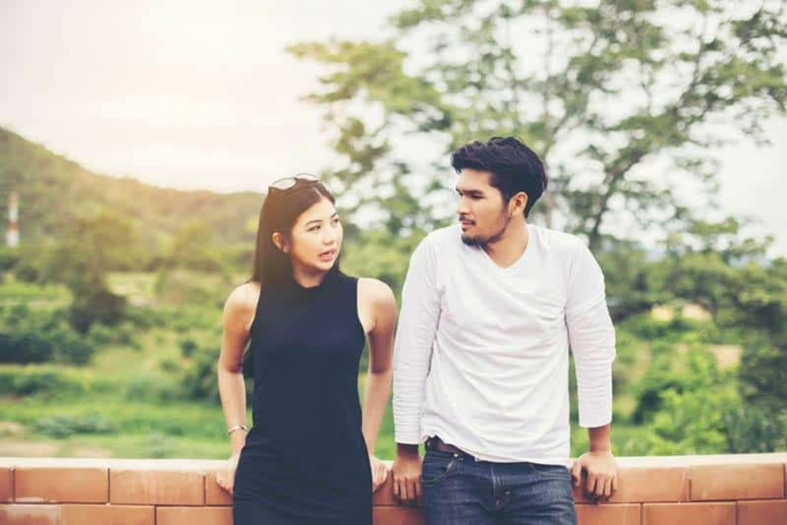 young couple having discussion in nature