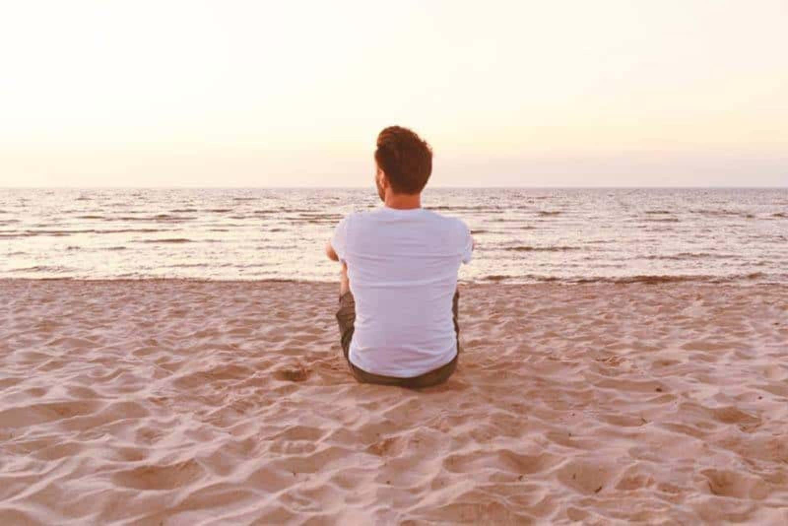 young man enjoying on the beach