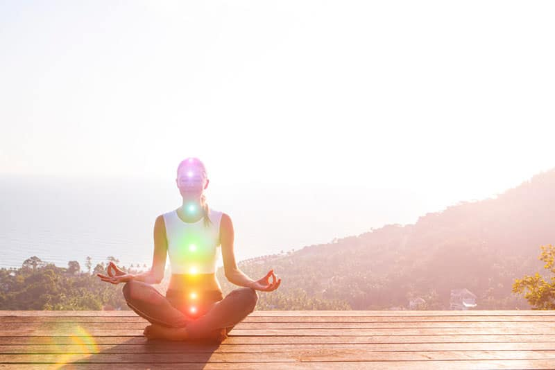 young woman meditates outdoor